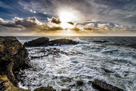 Ocean with clouds and sun
